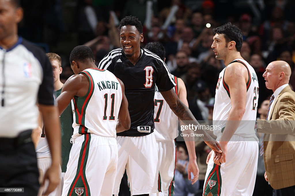 Larry Sanders #8 of the Milwaukee Bucks congratulates teammate Brandon Knight #11 after Knight's go-ahead 3-pointer with 1.5 seconds remaining against the New York Knicks on February 3, 2014 at the BMO Harris Bradley Center in Milwaukee, Wisconsin.