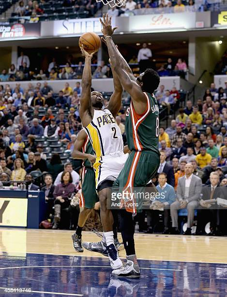 Larry Sanders of the Milwaukee Bucks defends Rodney Stuckey of the Indiana Pacers during the game at Bankers Life Fieldhouse on November 4 2014 in...
