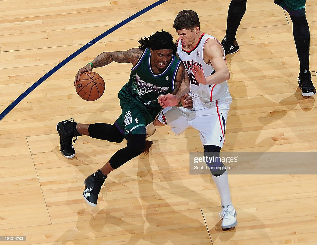 Larry Sanders #8 of the Milwaukee Bucks dribbles the ball against <a gi-track='captionPersonalityLinkClicked' href=/galleries/search?phrase=Kyle+Korver&family=editorial&specificpeople=202504 ng-click='$event.stopPropagation()'>Kyle Korver</a> #26 of the Atlanta Hawks on March 20, 2013 at Philips Arena in Atlanta, Georgia.