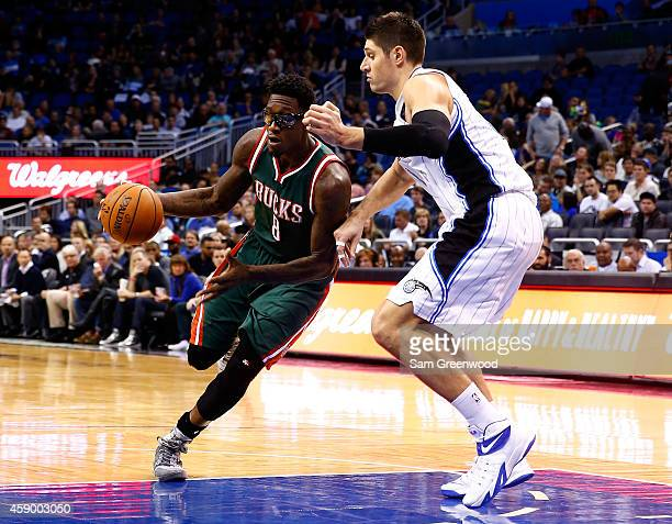 Larry Sanders of the Milwaukee Bucks drives against Nikola Vucevic of the Orlando Magic during the game at Amway Center on November 14 2014 in...