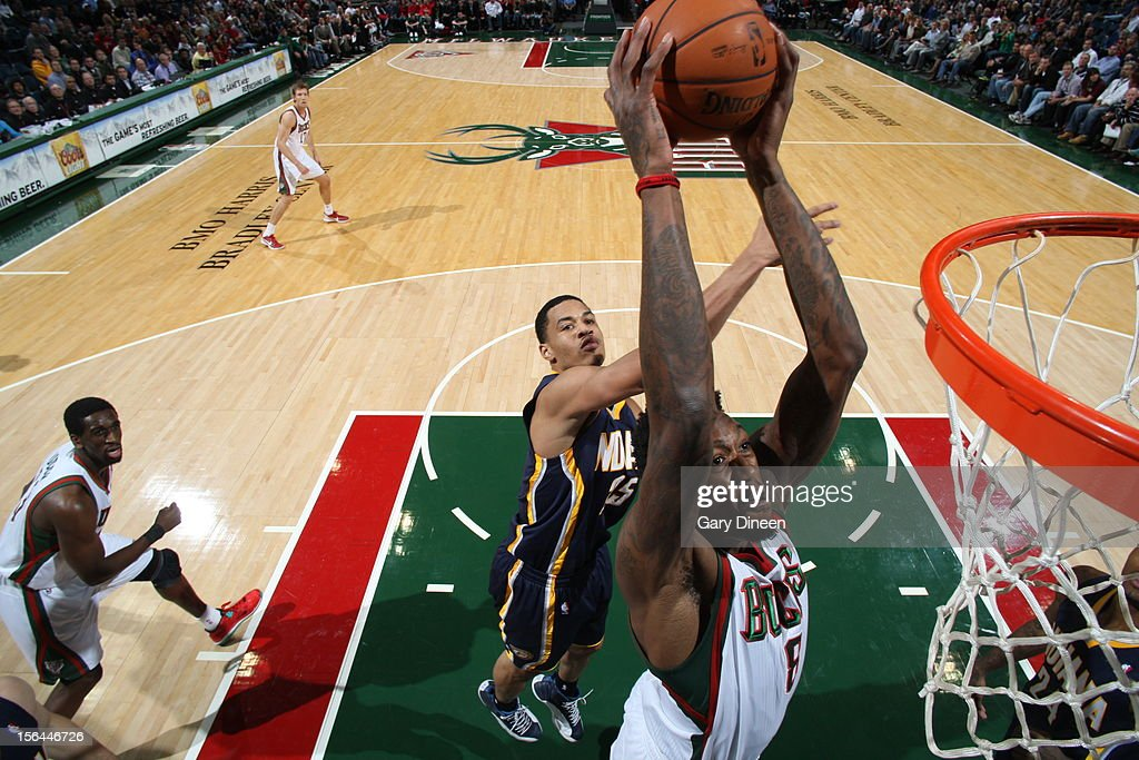 Larry Sanders #8 of the Milwaukee Bucks drives to the basket against <a gi-track='captionPersonalityLinkClicked' href=/galleries/search?phrase=Gerald+Green&family=editorial&specificpeople=644655 ng-click='$event.stopPropagation()'>Gerald Green</a> #25 of the Indiana Pacers during the NBA game on November 14, 2012 at the BMO Harris Bradley Center in Milwaukee, Wisconsin.