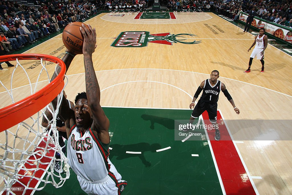 Larry Sanders #8 of the Milwaukee Bucks dunks against the Brooklyn Nets during the NBA game on December 26, 2012 at the BMO Harris Bradley Center in Milwaukee, Wisconsin.