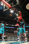 Larry Sanders of the Milwaukee Bucks dunks against the Charlotte Hornets during the game at the Time Warner Cable Arena on October 29 2014 in...