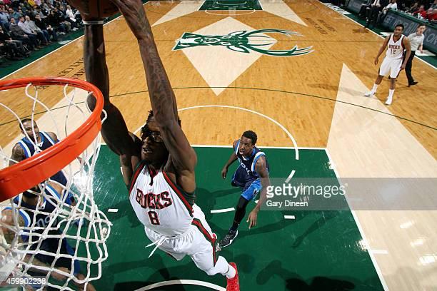Larry Sanders of the Milwaukee Bucks dunks against the Dallas Mavericks on December 3 2014 at the BMO Harris Bradley Center in Milwaukee Wisconsin...