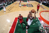 Larry Sanders of the Milwaukee Bucks dunks on a fast break against LeBron James and Udonis Haslem of the Miami Heat in Game Three of the Eastern...