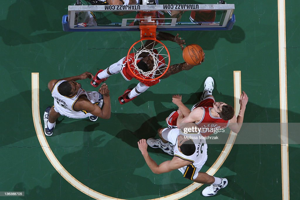 Larry Sanders of the Milwaukee Bucks goes for the layup past teammate Jon Leuer and Derrick Favors and Enes Kanter of the Utah Jazz at Energy...