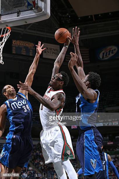Larry Sanders of the Milwaukee Bucks goes up for a dunk against the Dallas Mavericks on December 3 2014 at the BMO Harris Bradley Center in Milwaukee...