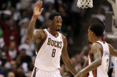 Larry Sanders of the Milwaukee Bucks high fives Brandon Jennings after drawing a foul against the Miami Heat during Game Three of the Western...