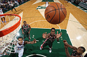Larry Sanders of the Milwaukee Bucks jumps for the rebound against the Philadelphia 76ers during the game on October 31 2014 at the BMO Harris...