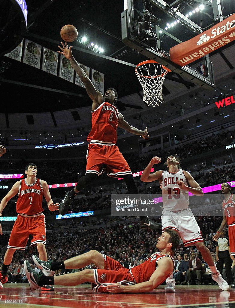 Larry Sanders #8 of the Milwaukee Bucks leaps to block a shot over teammates Ersan Ilyasova #7 and Mike Dunleavy #17 and Joakim Noah #13 of the Chicago Bulls at the United Center on January 9, 2013 in Chicago, Illinois. The Bucks defeated the Bulls 104-96.