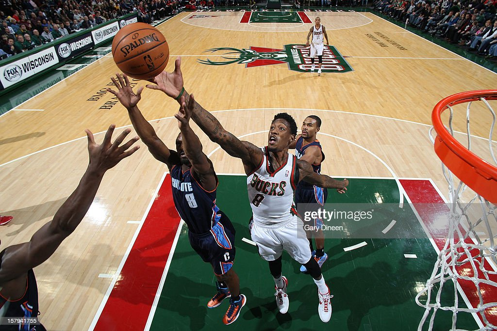 Larry Sanders #8 of the Milwaukee Bucks reaches for a rebound against <a gi-track='captionPersonalityLinkClicked' href=/galleries/search?phrase=Ben+Gordon&family=editorial&specificpeople=202181 ng-click='$event.stopPropagation()'>Ben Gordon</a> #8 of the Charlotte Bobcats during the game on December 7, 2012 at the BMO Harris Bradley Center in Milwaukee, Wisconsin.