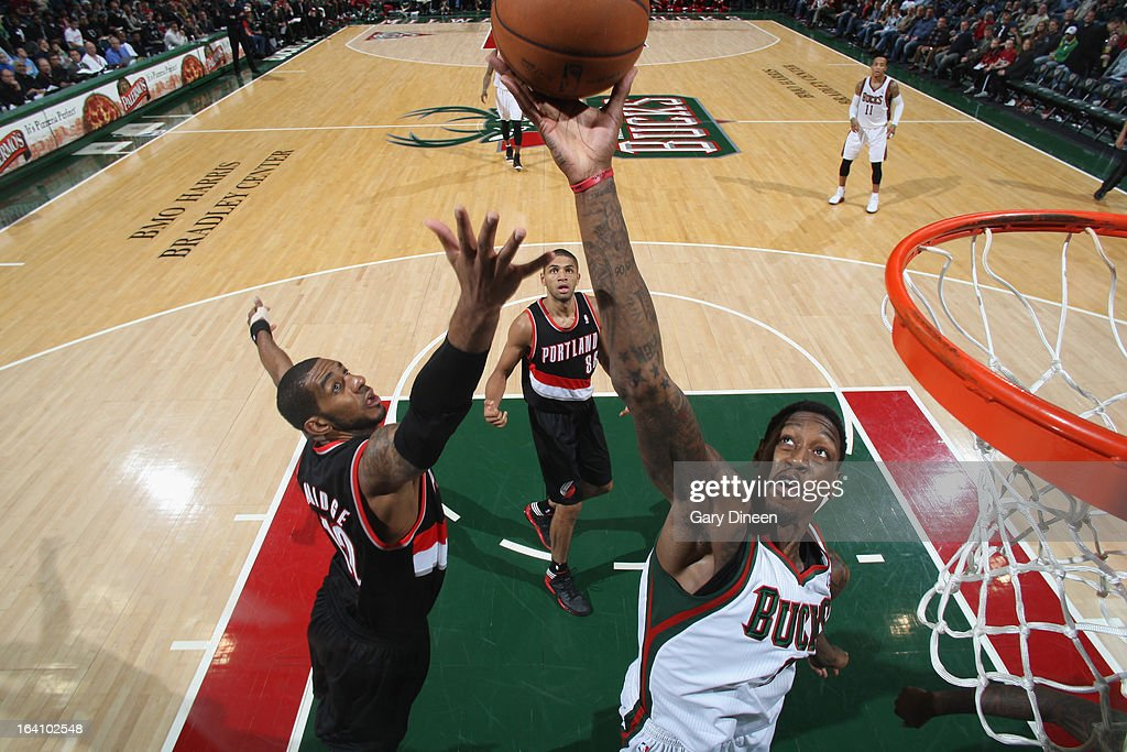 Larry Sanders #8 of the Milwaukee Bucks reaches for a rebound against LaMarcus Aldridge #12 of the Portland Trail Blazers on March 19, 2013 at the BMO Harris Bradley Center in Milwaukee, Wisconsin.