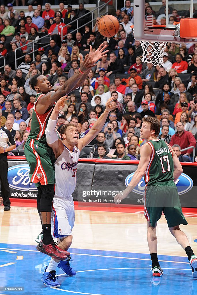 Larry Sanders #8 of the Milwaukee Bucks reaches for a rebound against <a gi-track='captionPersonalityLinkClicked' href=/galleries/search?phrase=Blake+Griffin+-+Basketball+Player&family=editorial&specificpeople=4216010 ng-click='$event.stopPropagation()'>Blake Griffin</a> #32 of the Los Angeles Clippers at Staples Center on March 6, 2013 in Los Angeles, California.