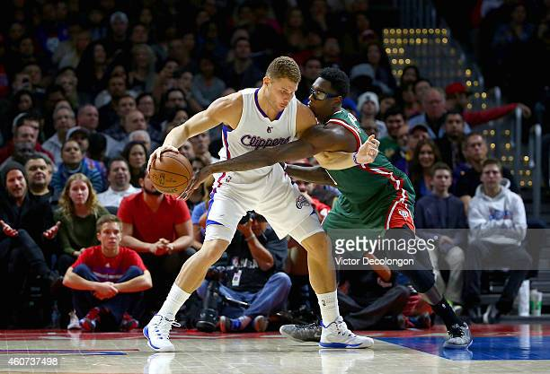 Larry Sanders of the Milwaukee Bucks reaches for the ball as Blake Griffin of the Los Angeles Clippers keeps the ball from Sanders' reach in the...