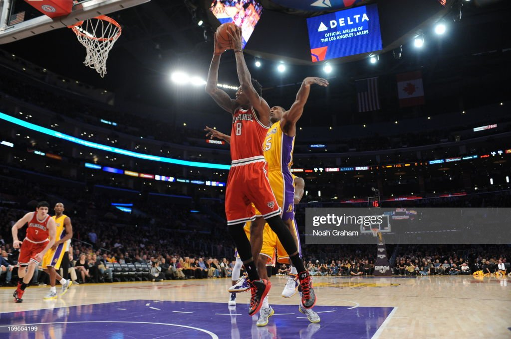 Larry Sanders #8 of the Milwaukee Bucks rises for a shot against Metta World Peace #15 of the Los Angeles Lakers at Staples Center on January 15, 2013 in Los Angeles, California.