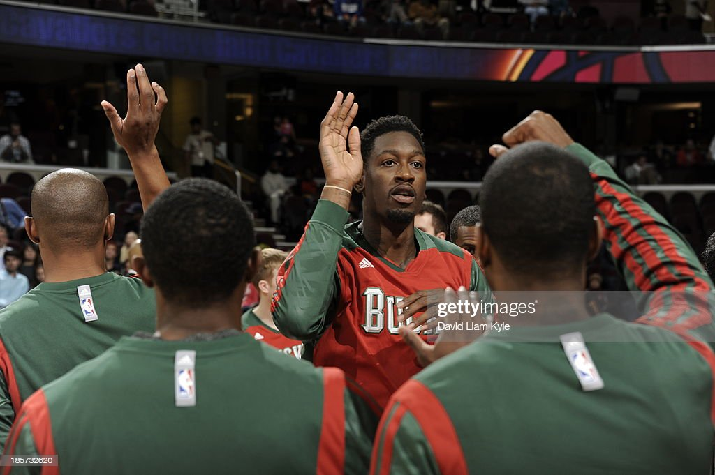 Larry Sanders #8 of the Milwaukee Bucks runs out before the game against the Cleveland Cavaliers at The Quicken Loans Arena on October 8, 2013 in Cleveland, Ohio.