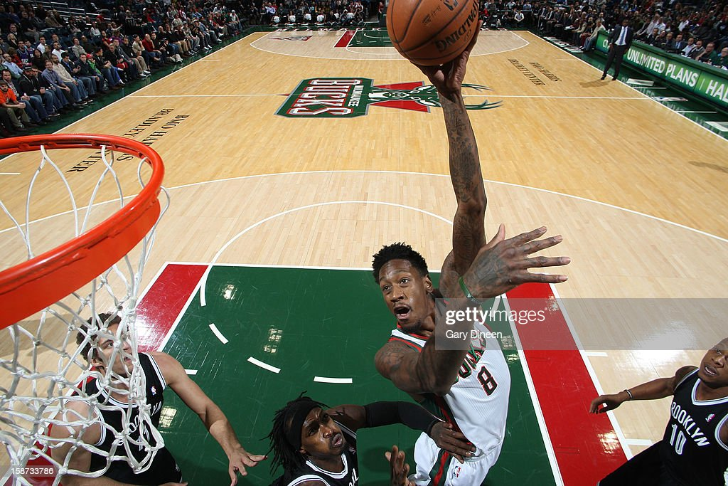 Larry Sanders #8 of the Milwaukee Bucks shoots against <a gi-track='captionPersonalityLinkClicked' href=/galleries/search?phrase=Gerald+Wallace&family=editorial&specificpeople=202117 ng-click='$event.stopPropagation()'>Gerald Wallace</a> #45 of the Brooklyn Nets the NBA game on December 26, 2012 at the BMO Harris Bradley Center in Milwaukee, Wisconsin.