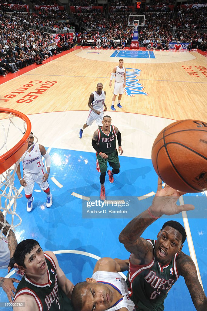 Larry Sanders #8 of the Milwaukee Bucks shoots against <a gi-track='captionPersonalityLinkClicked' href=/galleries/search?phrase=Grant+Hill+-+Basketspelare&family=editorial&specificpeople=201658 ng-click='$event.stopPropagation()'>Grant Hill</a> #33 of Los Angeles Clippers at Staples Center on March 6, 2013 in Los Angeles, California.