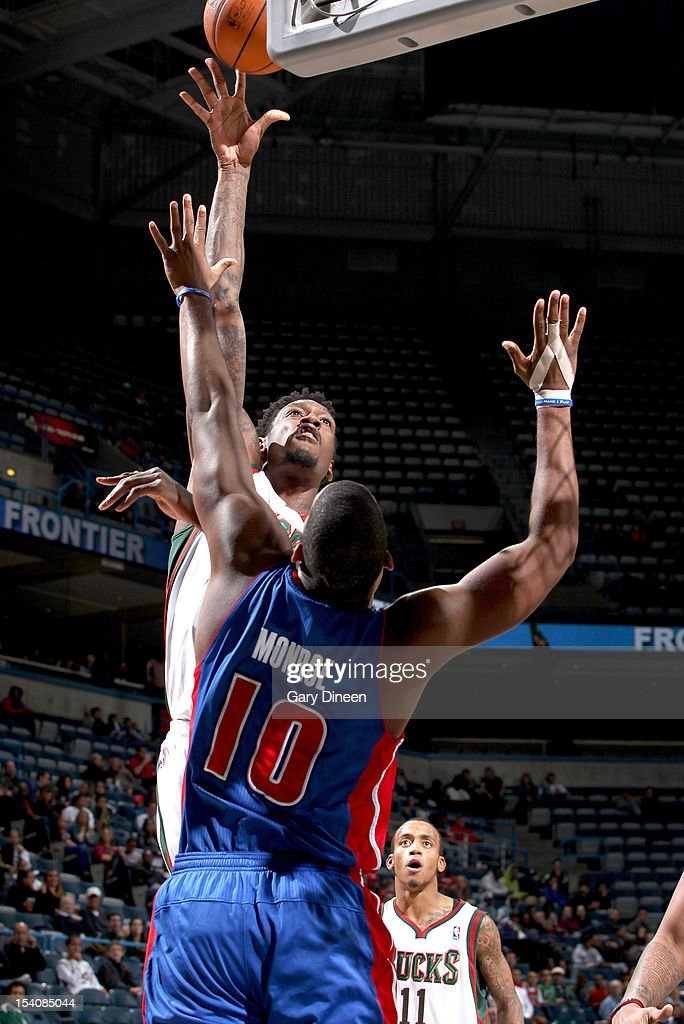Larry Sanders #8 of the Milwaukee Bucks shoots against <a gi-track='captionPersonalityLinkClicked' href=/galleries/search?phrase=Greg+Monroe&family=editorial&specificpeople=5042440 ng-click='$event.stopPropagation()'>Greg Monroe</a> #10 of the Detroit Pistons during the NBA preseason game on October 13, 2012 at the BMO Harris Bradley Center in Milwaukee, Wisconsin.