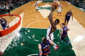 Larry Sanders of the Milwaukee Bucks shoots against Miles Plumlee of the Phoenix Suns on January 29 2014 at the BMO Harris Bradley Center in...