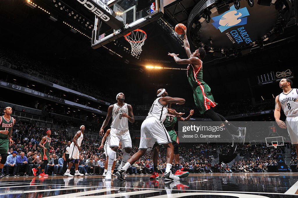 Larry Sanders #8 of the Milwaukee Bucks shoots against Reggie Evans #30 of the Brooklyn Nets during the game at the Barclays Center on December 9, 2012 in Brooklyn, New York.