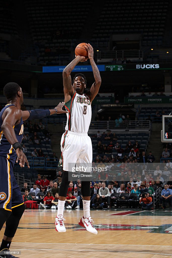 Larry Sanders #8 of the Milwaukee Bucks shoots against Roy Hibbert #55 of the Indiana Pacers during the game on December 18, 2012 at the BMO Harris Bradley Center in Milwaukee, Wisconsin.