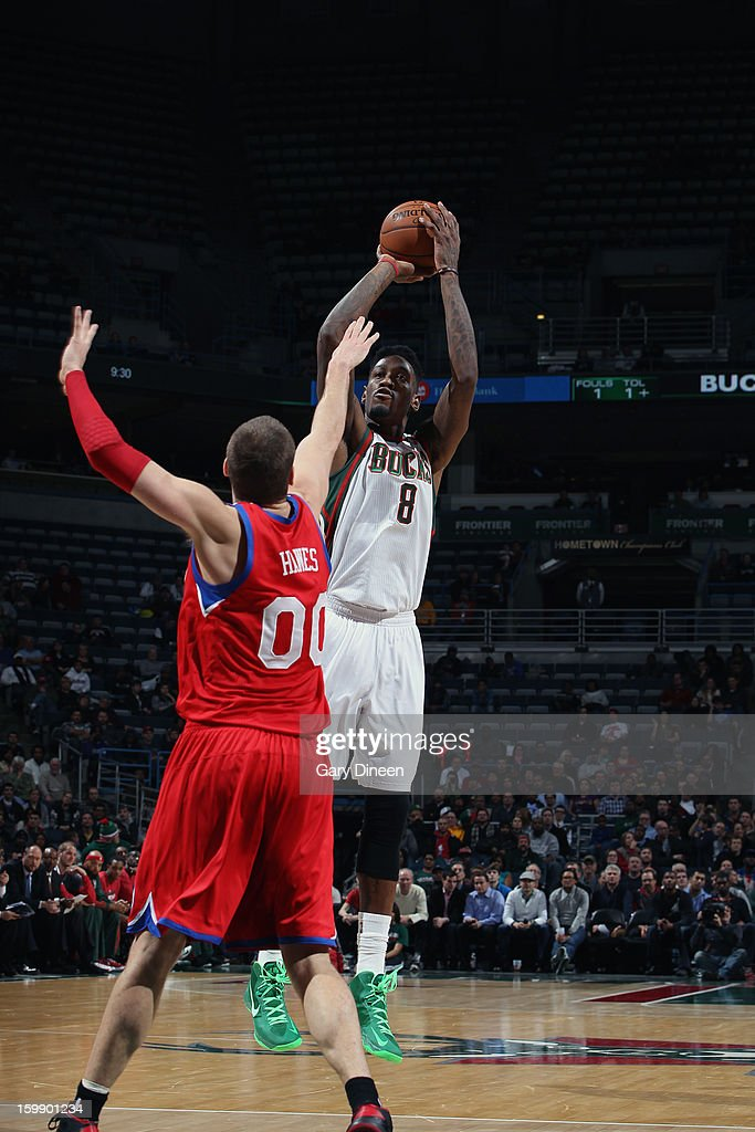 Larry Sanders #8 of the Milwaukee Bucks shoots against <a gi-track='captionPersonalityLinkClicked' href=/galleries/search?phrase=Spencer+Hawes&family=editorial&specificpeople=3848319 ng-click='$event.stopPropagation()'>Spencer Hawes</a> #00 of the Philadelphia 76ers on January 22, 2013 at the BMO Harris Bradley Center in Milwaukee, Wisconsin.