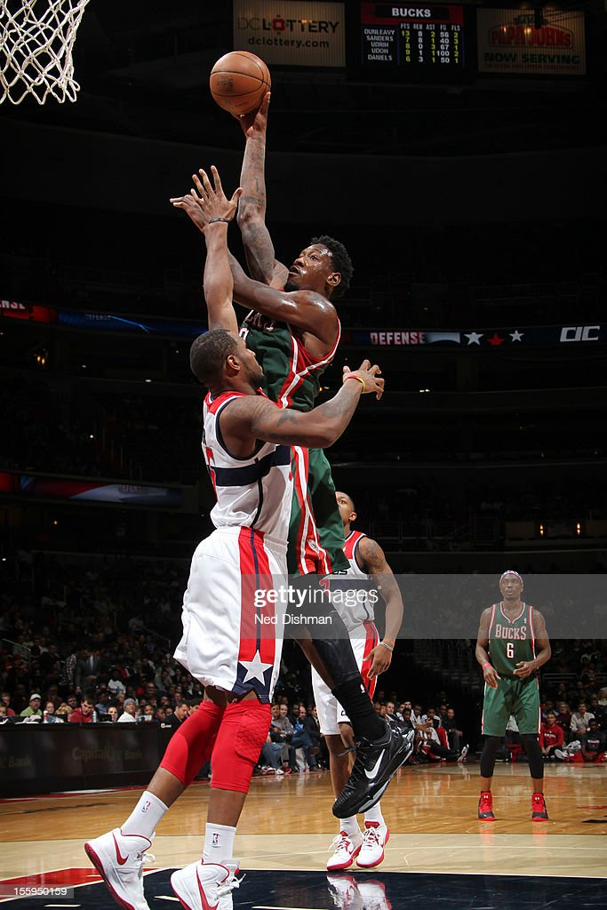 Larry Sanders #8 of the Milwaukee Bucks shoots against <a gi-track='captionPersonalityLinkClicked' href=/galleries/search?phrase=Trevor+Booker&family=editorial&specificpeople=4123563 ng-click='$event.stopPropagation()'>Trevor Booker</a> #35 of the Washington Wizards during the game at the Verizon Center on November 9, 2012 in Washington, DC.