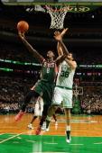 Larry Sanders of the Milwaukee Bucks shoots against Vitor Faverani of the Boston Celtics on November 1 2013 at the TD Garden in Boston Massachusetts...