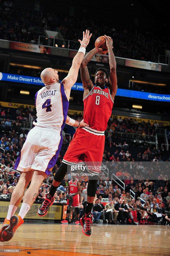 Larry Sanders #8 of the Milwaukee Bucks shoots over top against Marcin Gortat #4 the Phoenix Suns on January 17, 2013 at U.S. Airways Center in Phoenix, Arizona.