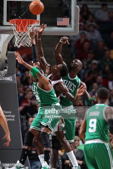 Larry Sanders of the Milwaukee Bucks tips in a missed shot against Paul Pierce and Kevin Garnett of the Boston Celtics during the NBA game on March 6...