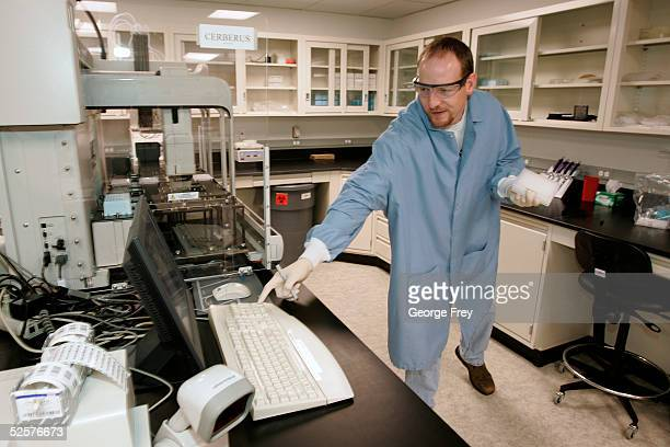 Larry Stewart a lab technician for Sorenson Genomics sets up a machine to amplify DNA of victims of the last December's Indian Ocean tsunami April 1...