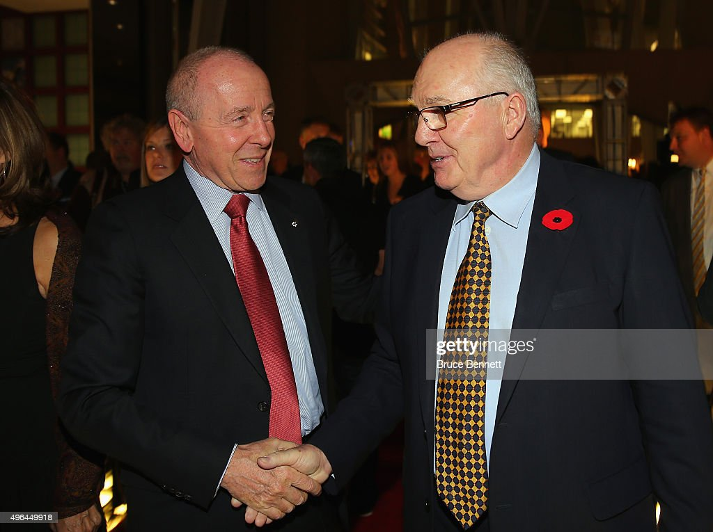 <a gi-track='captionPersonalityLinkClicked' href=/galleries/search?phrase=Larry+Tanenbaum&family=editorial&specificpeople=695587 ng-click='$event.stopPropagation()'>Larry Tanenbaum</a> and Ron Ellis walk the red carpet prior to the 2015 Hockey Hall of Fame Induction Ceremony at Brookfield Place on November 9, 2015 in Toronto, Ontario, Canada.