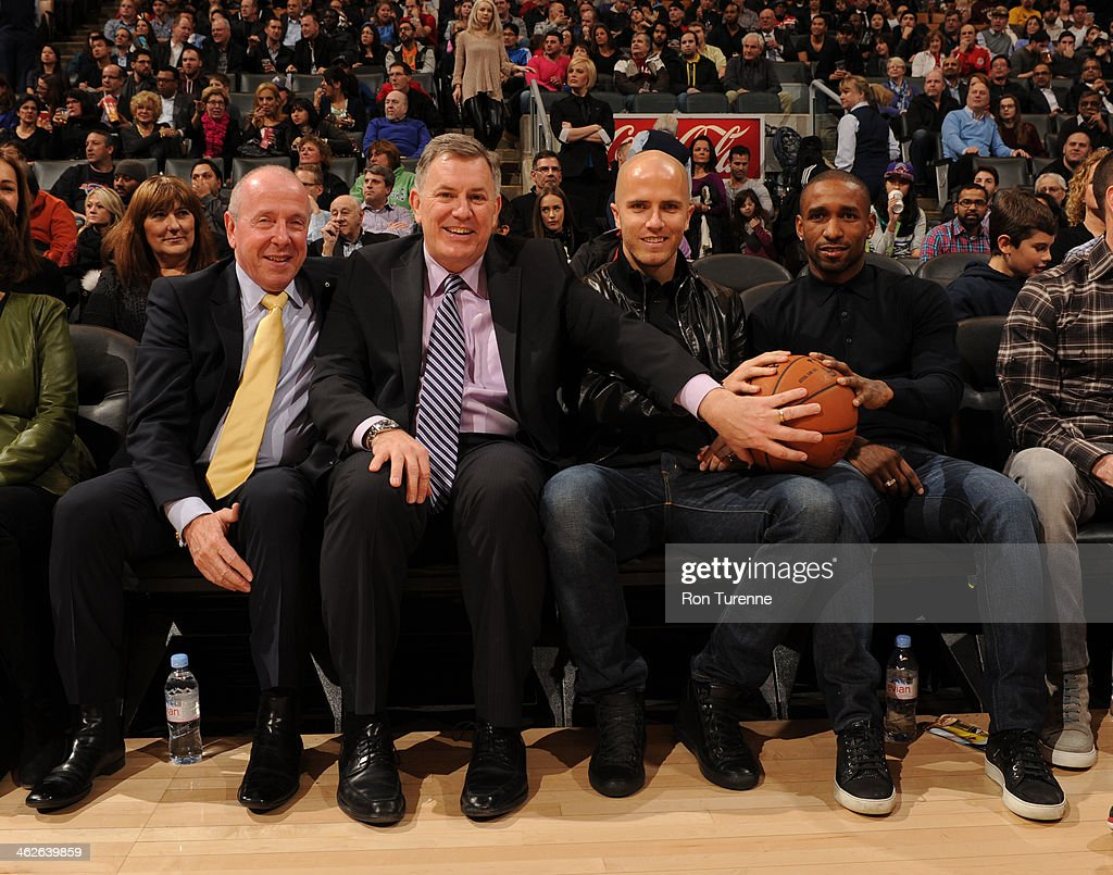 Larry Tanenbaum, the Chairman of Maple Leaf Sports & Entertainment, Timothy Leiweke the president and CEO of Maple Leaf Sports & Entertainment, Michael Bradley and Jermain Defoe of Toronto FC of Major League Soccer attend the Milwaukee Bucks game against the Toronto Raptors on January 13, 2014 at the Air Canada Centre in Toronto, Ontario, Canada.
