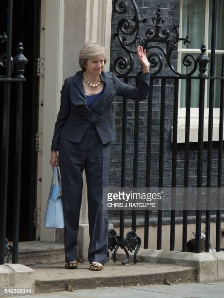 Larry the Downing Street cat looks up as Britain's Home Secretary and new Conservative Party leader Theresa May arrives at the front door of 10...