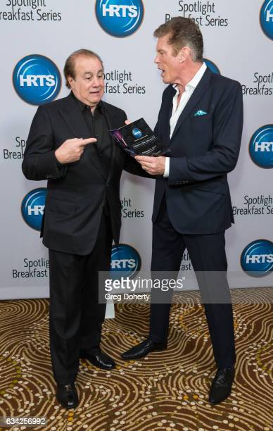 Larry Thompson and Actor David Hasselhoff attend The Hollywood Radio And Television Society Presents The Newsmaker Luncheon Series A Moment In Time...