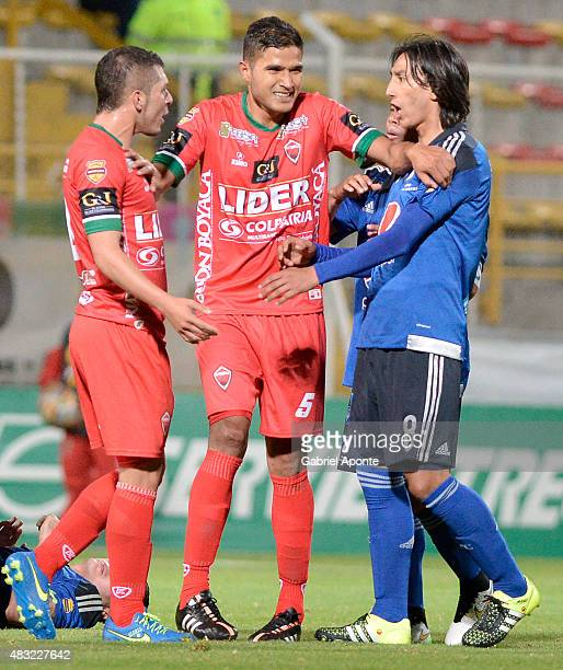 Larry Vasquez of Patriotas FC separates his teammate Leonardo Pico and Rafael Robayo of Millonarios during a match between Patriotas FC and...