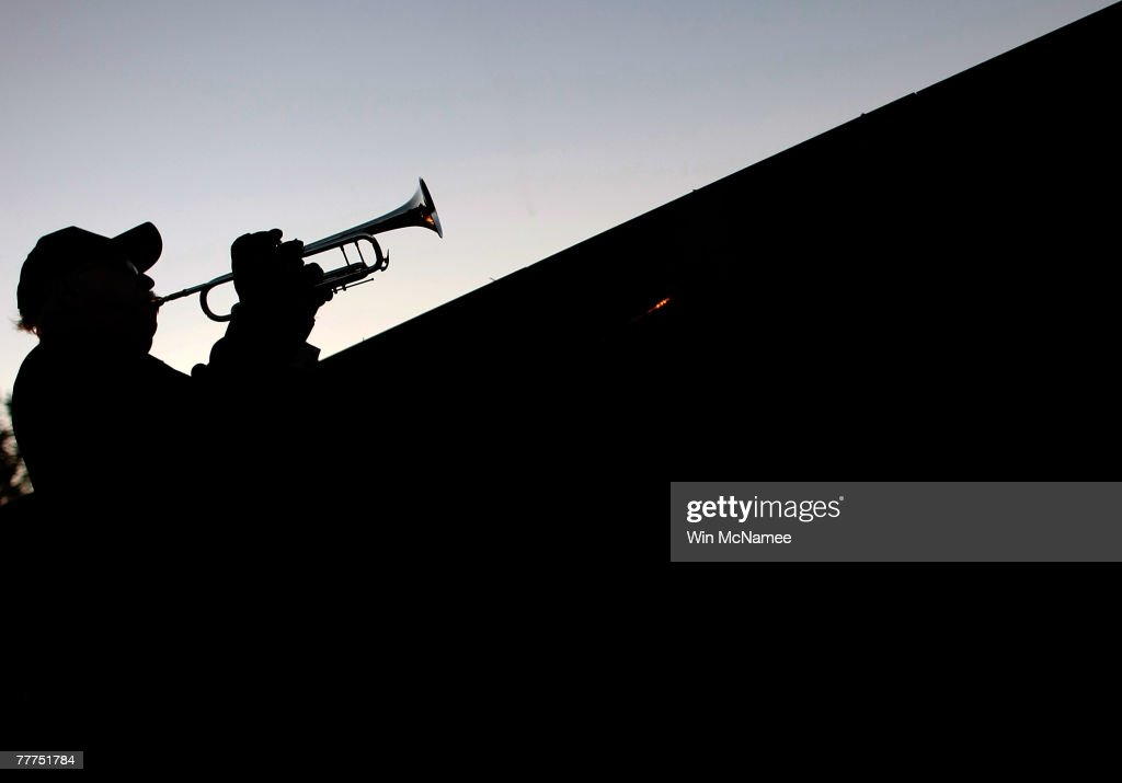 Larry Wiseman plays Taps on his bugle at sunset in front of the more than 53000 names of US causalities carved into the Vietnam Veterans Memorial are...