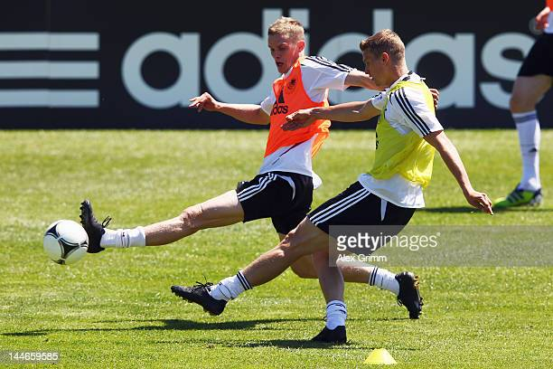 Lars Bender is challenged by his brother Sven Bender during a Germany training session at Campo Sportivo Comunale Andrea Corda on May 17 2012 in...