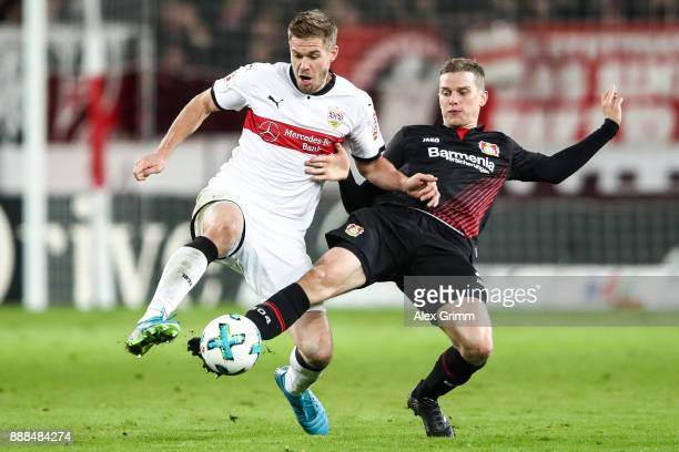 Lars Bender of Bayer Leverkusen and Simon Terodde of VfB Stuttgart battle for the ball during the Bundesliga match between VfB Stuttgart and Bayer 04...