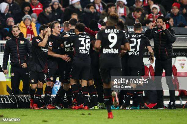 Lars Bender of Bayer Leverkusen celebrates with his teammates after scoring his team's second goal to make it 01 during the Bundesliga match between...