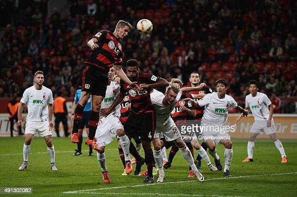 Lars Bender of Bayer Leverkusen heads the ball during the Bundesliga match between Bayer Leverkusen and FC Augsburg at BayArena on October 4 2015 in...