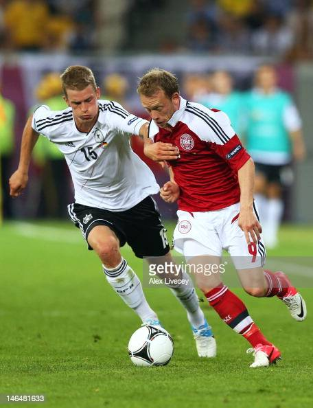 L'VIV UKRAINE JUNE 17 Lars Bender of Germany and Michael KrohnDehli of Denmark compete for the ball during the UEFA EURO 2012 group B match between...