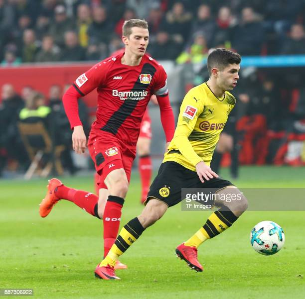 Lars Bender of Leverkusen and Christian Pulisic of Dortmund battle for the ball during the Bundesliga match between Bayer 04 Leverkusen and Borussia...