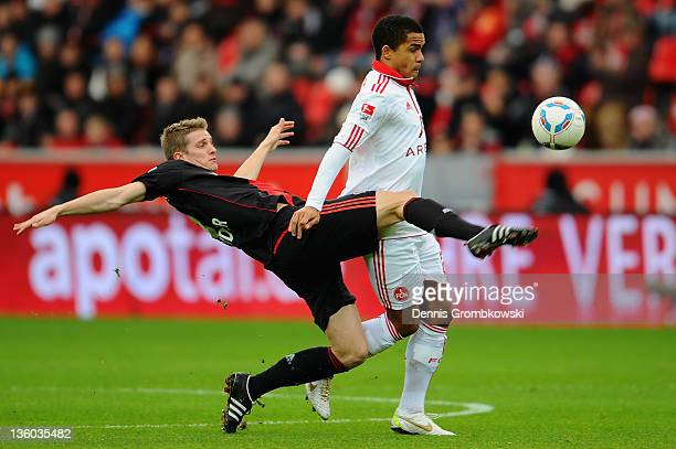 Lars Bender of Leverkusen and Daniel Didavi of Nuernberg battle for the ball during the Bundesliga match between Bayer 04 Leverkusen and 1 FC...