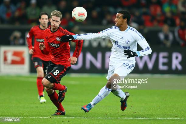 Lars Bender of Leverkusen and Joel Matip of Schalke fight for the ball during the Bundesliga match between Bayer 04 Leverkusen and FC Schalke 04 at...