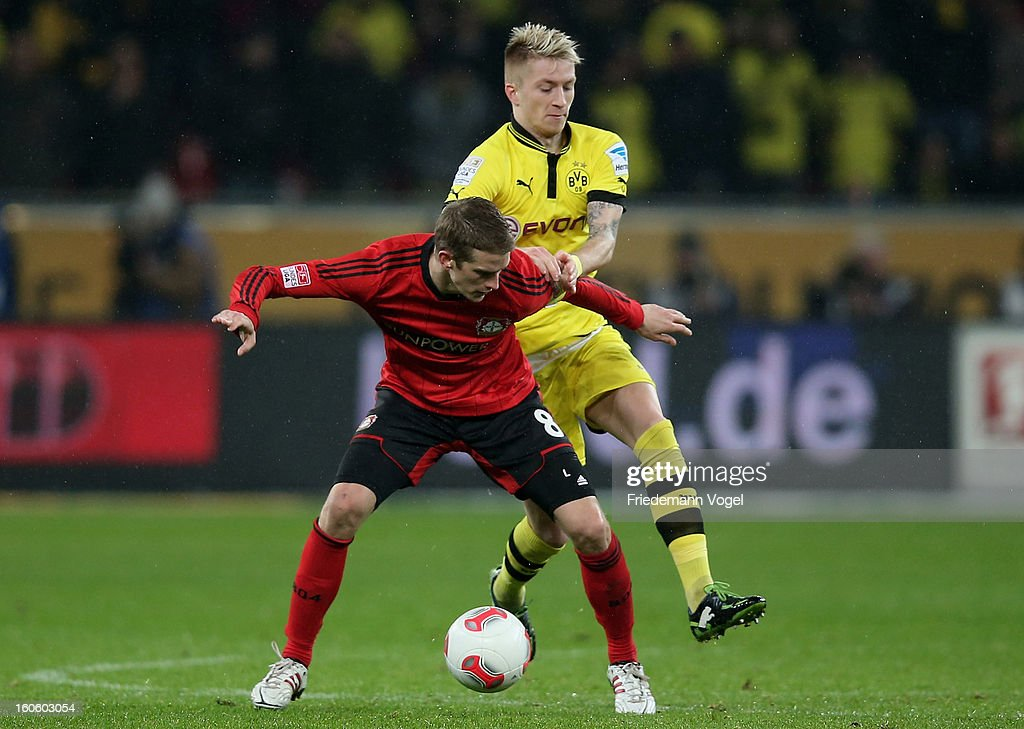 Lars Bender of Leverkusen and Marco Reus of Dortmund battle for the ball during the Bundesliga match between Bayer 04 Leverkusen and Borussia Dortmund at BayArena on February 3, 2013 in Leverkusen, Germany.