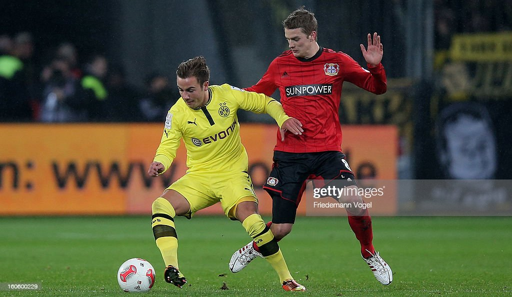 Lars Bender (R) of Leverkusen and Mario Goetze (L) of Dortmund battle for the ball during the Bundesliga match between Bayer 04 Leverkusen and Borussia Dortmund at BayArena on February 3, 2013 in Leverkusen, Germany.