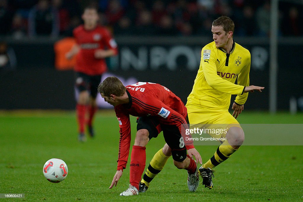 Lars Bender of Leverkusen and Sven Bender of Dortmund battle for the ball during the Bundesliga match between Bayer 04 Leverkusen and Borussia Dortmund at BayArena on February 3, 2013 in Leverkusen, Germany.