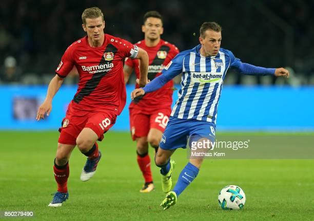 Lars Bender of Leverkusen battles for the ball with Vladimir Darida of Berlin during the Bundesliga match between Hertha BSC and Bayer 04 Leverkusen...